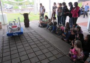 grade schoolers watching robot